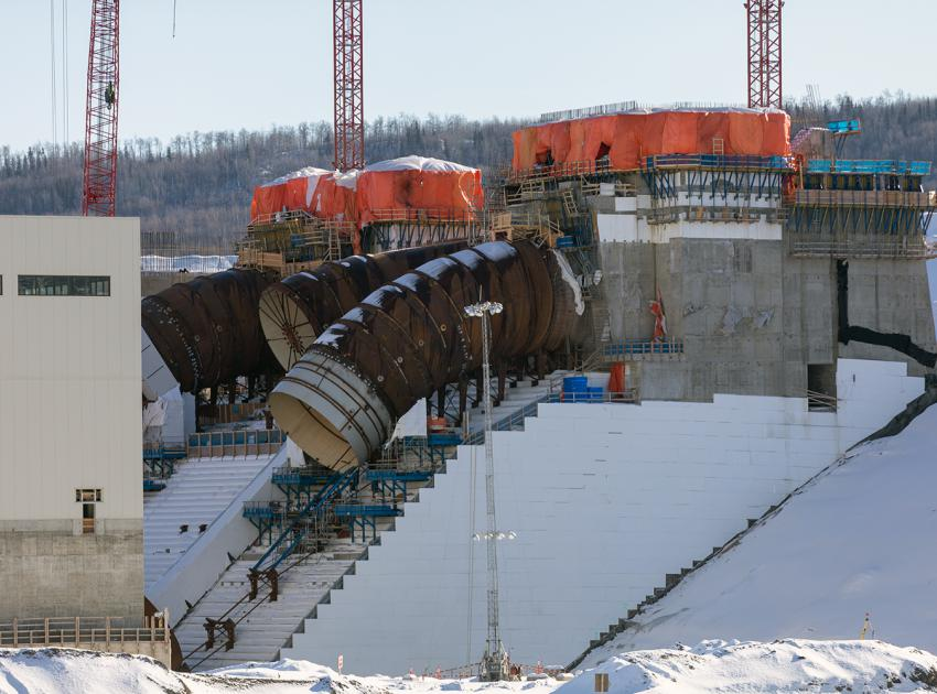 Units 1, 2 and 3 penstock construction. Unit 1 shows the flexible coupling in place. (February 2020)