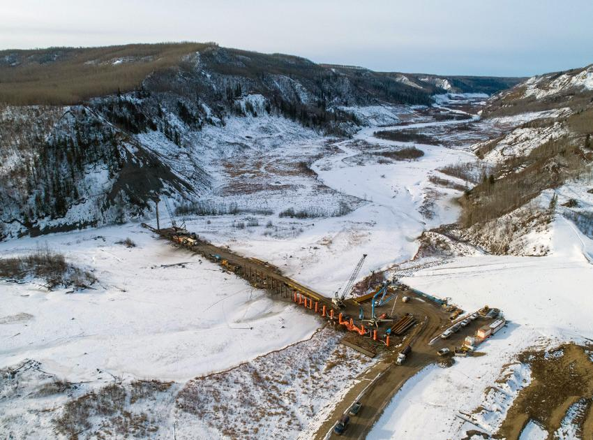 An aerial view of the Moberly River pile structure under construction. This structure, in combination with a debris boom, will be used to capture debris floating in the river. (February 2020)