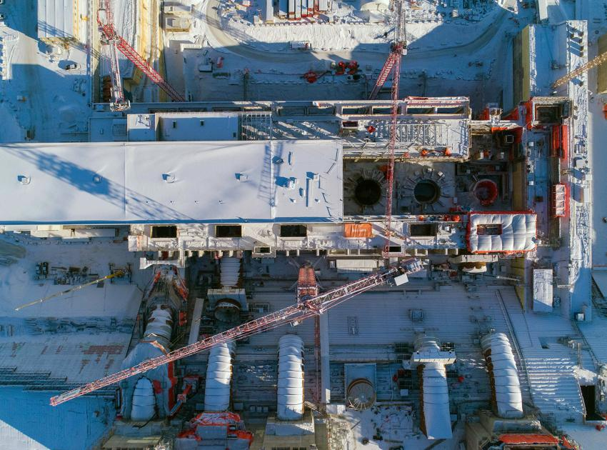 Aerial view of five of six penstocks under construction. A penstock is a large steel pipe in a hydroelectric generating station that brings water from the reservoir to a turbine. (February 2021)