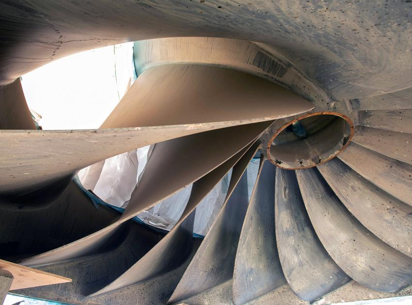 The runner is the rotating part of a turbine that converts the gravitational energy of falling water into mechanical energy, which then spins a generator to produce clean hydroelectric power. (January 2021)