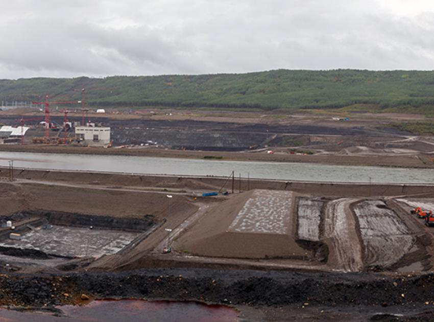The core trenches are excavated on the right and left banks to provide the foundation for the earthfill dam's impermeable core. (September 2019)