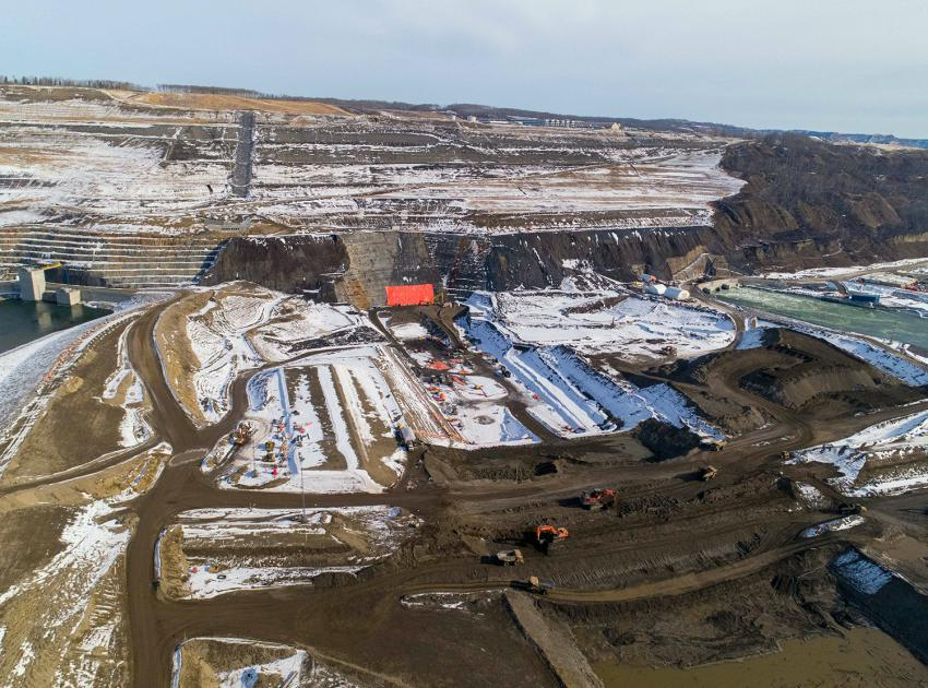 Crews remove a cofferdam in the foreground that separated the right and left bank, with the left bank core trench at top centre. (March 2021)