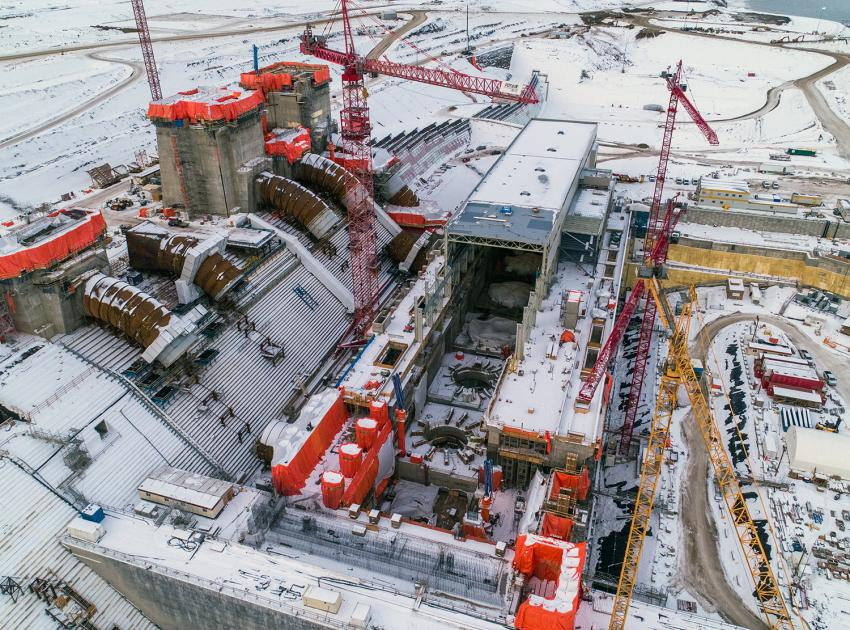 An aerial view of the Site C powerhouse, penstocks and intakes. (January 2021)
