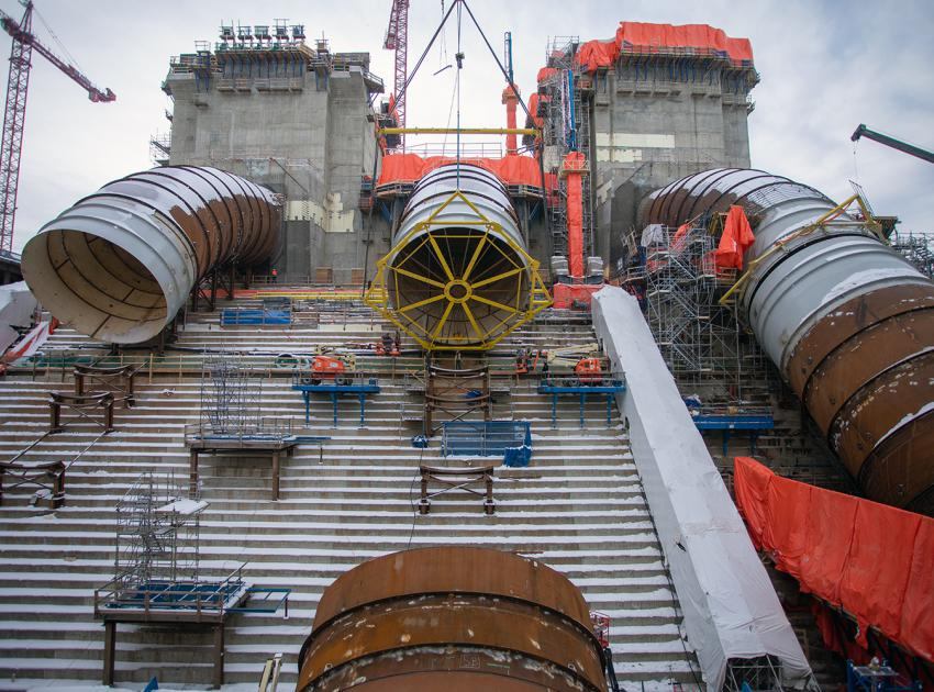 A penstock piece is lowered into place as part of the penstock installation for Unit 2. (November 2020)