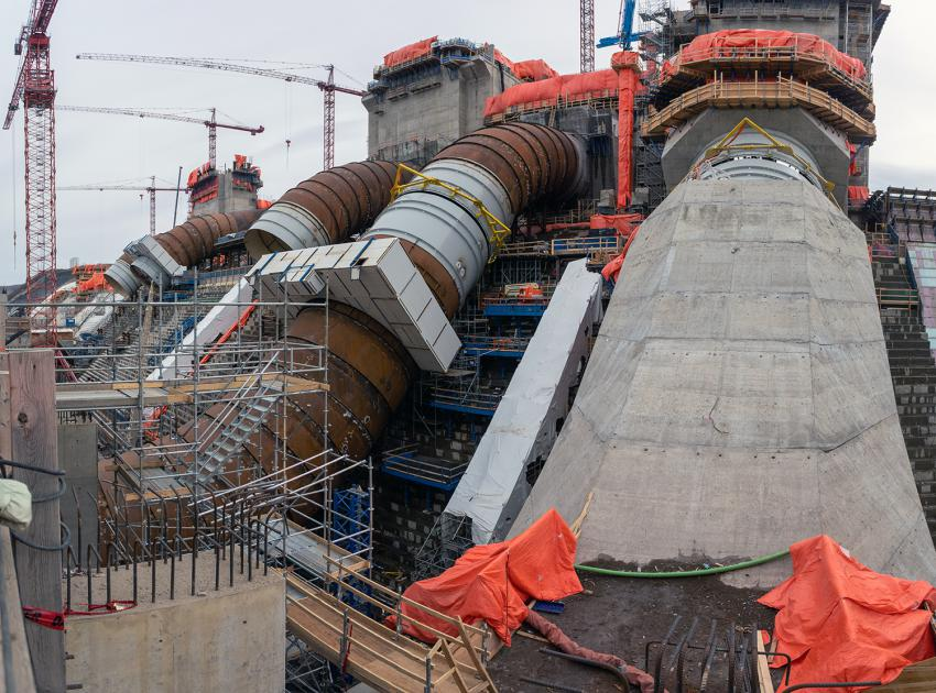 The generating station will have six penstocks to direct water into its six turbine and generator units. Unit 1 penstock is almost complete with crews currently working on the concrete casing. (April 2021)