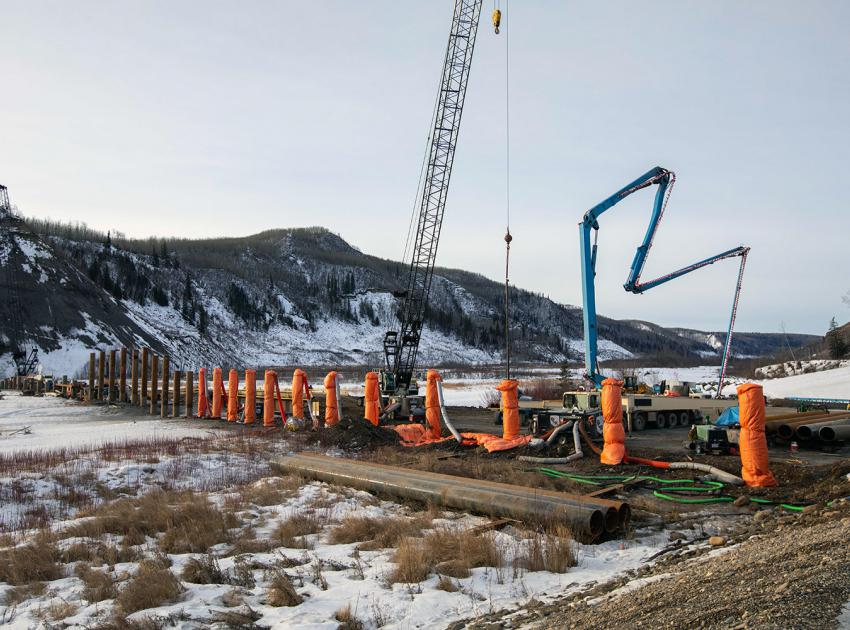 Moberly River piles are cut to final elevation, filled with concrete and tarped to maintain adequate temperature during the curing process. (February 2020)
