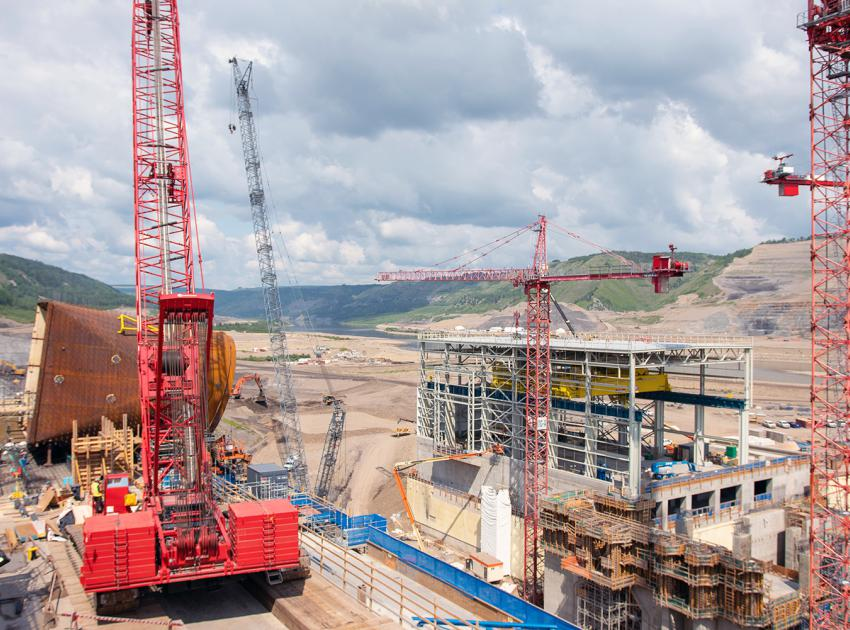 Cranes lift a penstock intake piece for installation. (Summer 2019)
