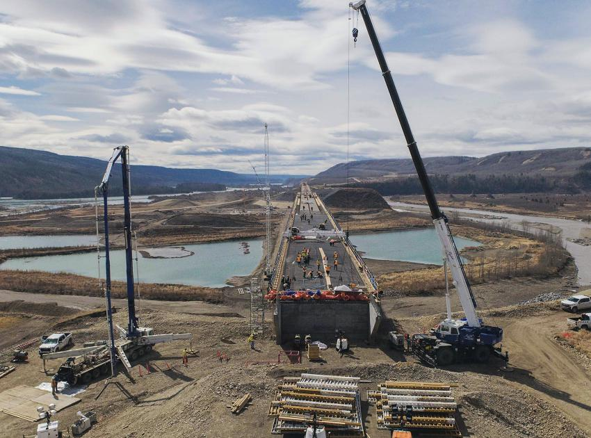 Preparing the Halfway River bridge deck for the first concrete placement on April 29. Concrete is placed using a concrete pump truck and then levelled with a screed machine. (April 2021)