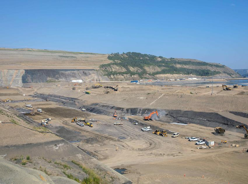 There is a lot of activity happening in the dam core trench, including drying glacial till, cleaning the bedrock layer and placing filters and aggregates. (August 2021)