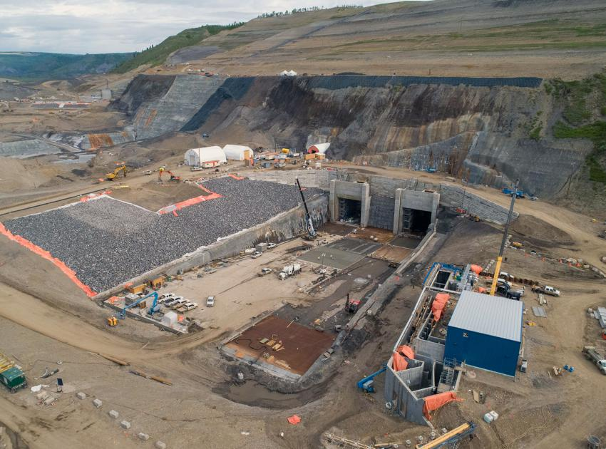 The completed diversion tunnels outlet portals on the north bank and temporary fishway (pictured lower right) nearing completion. (May 2020)