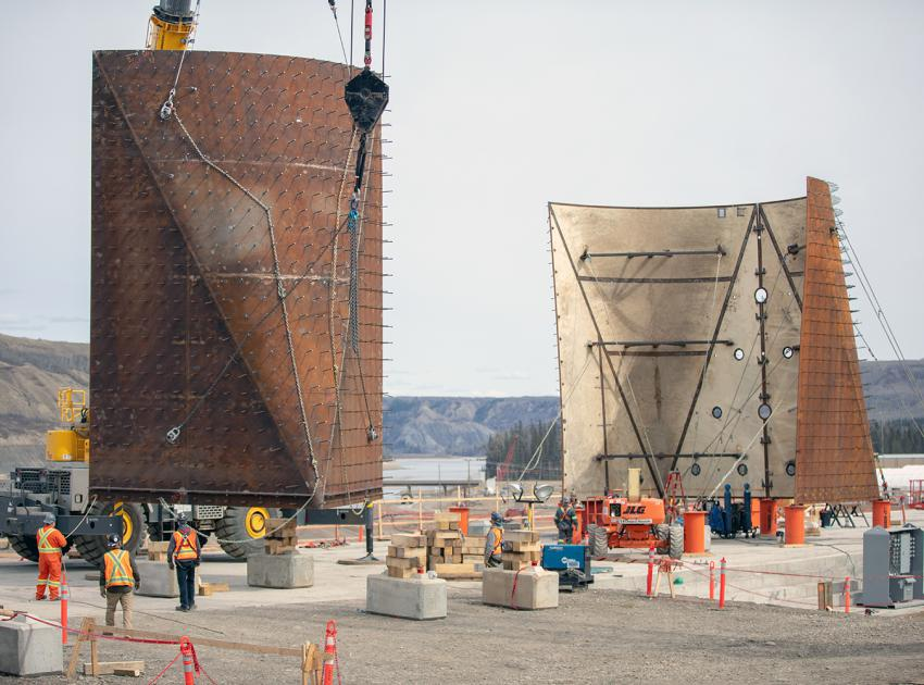 Transition piece for the Unit 1 penstock is hoisted onto an assembly stand and weighs 13,243 kg. (Spring 2019)