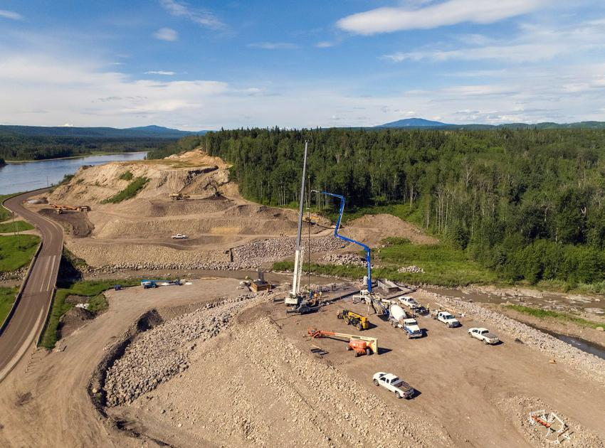 Crews pour concrete on the east abutment of the Lynx Creek alignment on Highway 29. (June 2021)