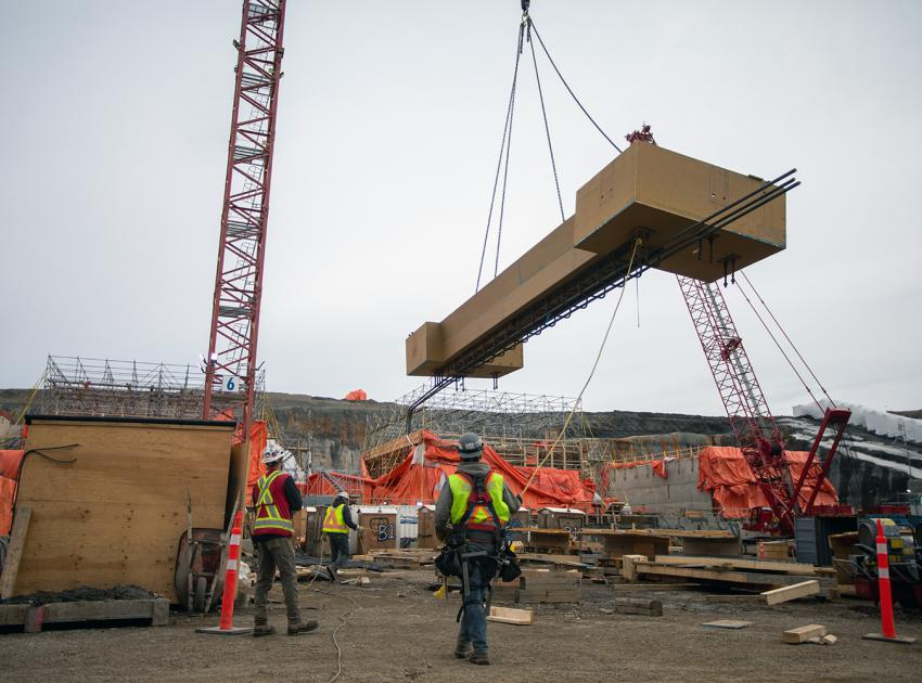 Crews use a crane to lift formwork for placement at the spillway headworks. (April 2021)