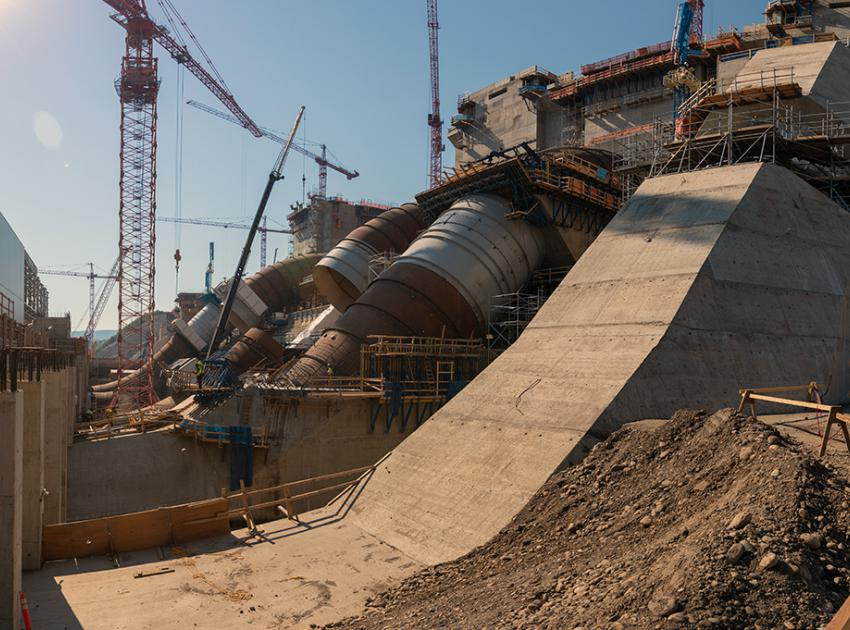 East-facing view of five of six penstock units in varying stages of construction. (July 2021)