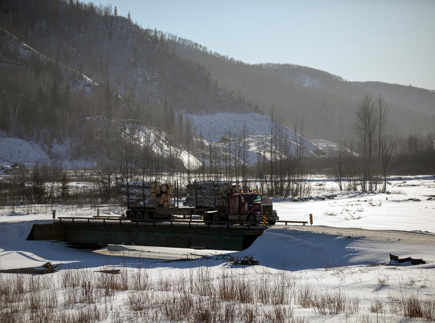 Processed logs are hauled to a mill in Fort St. John across a winter crossing in the Moberly River drainage area. (Spring 2019)