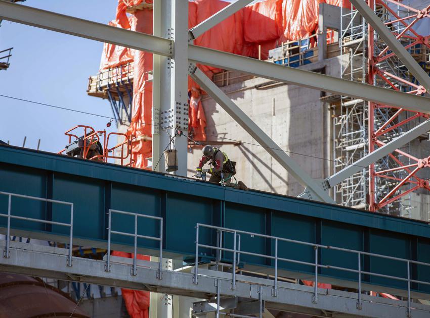 Crews install a crane rail in the powerhouse. (February 2021)