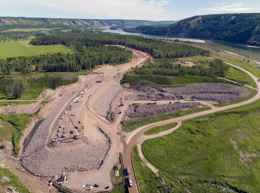 At Lynx Creek, crews prepare the east abutment where two bridge piers will be constructed for the new 150-metre bridge. (June 2021)