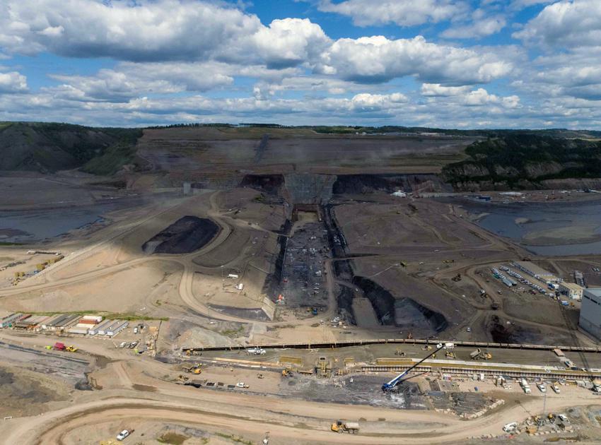 Crews excavate and prepare the dam core area in advance of earthfill dam construction. (June 2021)