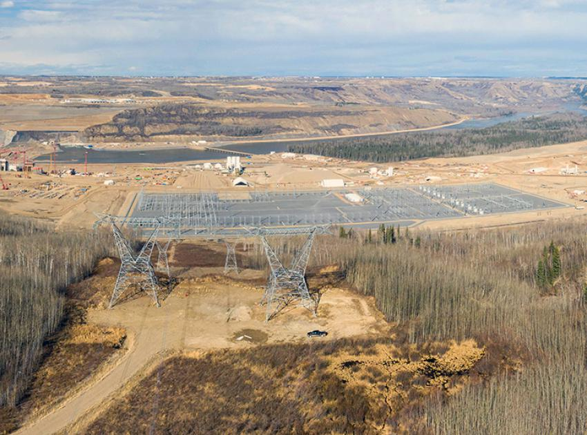 Transmission towers for two new transmission lines stand side-by-side above the completed Site C substation. (April 2021)