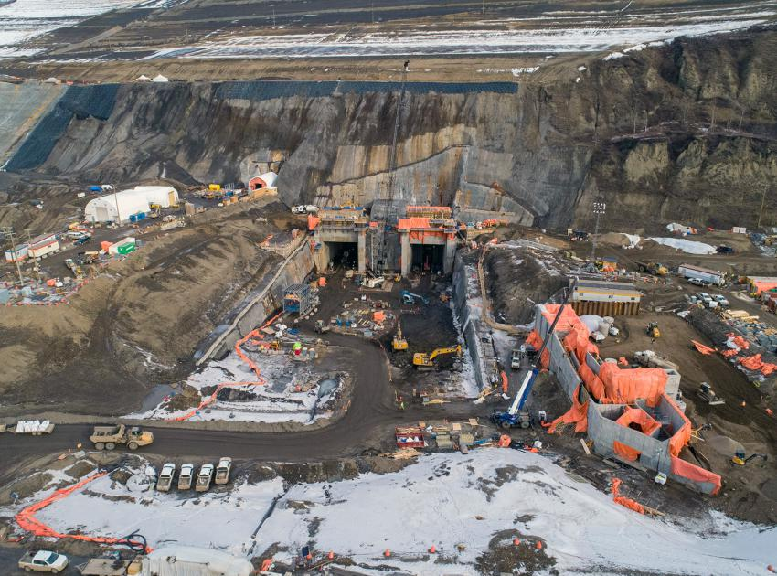 Aerial view of the diversion tunnel outlet portals and the temporary fish passage facility under construction. (February 2020)