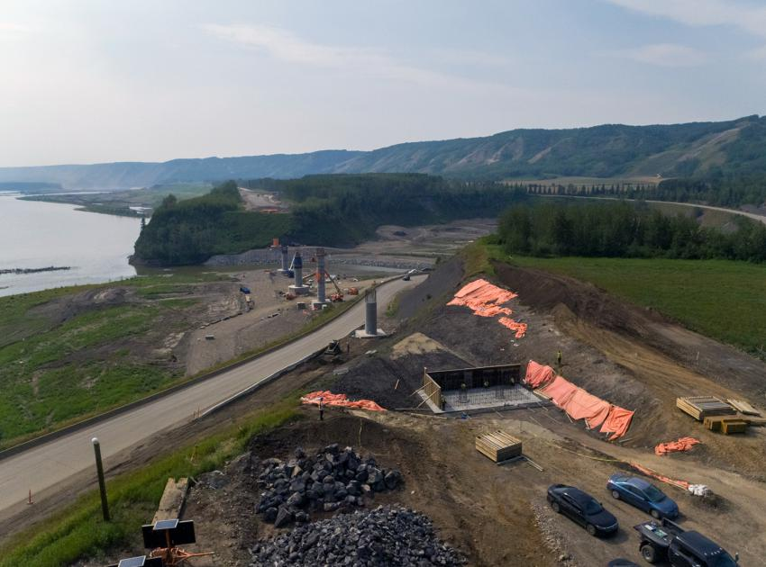 Highway 29 alignment at Farrell Creek in varying stages of construction, showing the abutments at either end with five bridge piers. (July 2021)