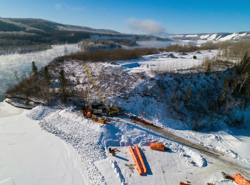 Crews drill piles for pier 1 of the Farrell Creek bridge. Construction is underway on the new highway segment and bridge at Farrell Creek. (February 2021)