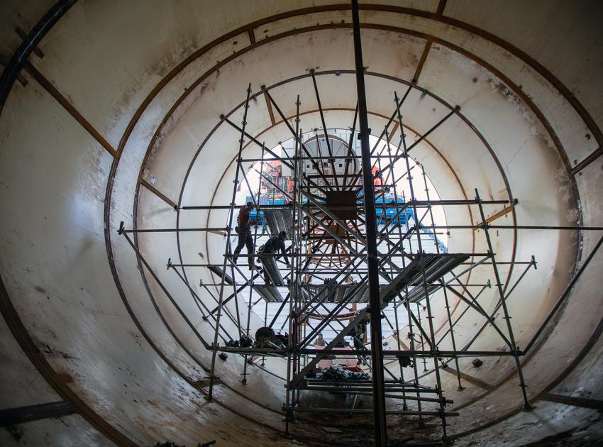 Scaffolding is installed inside a penstock to allow access around the circumference of the unit to weld sections together. (November 2019)