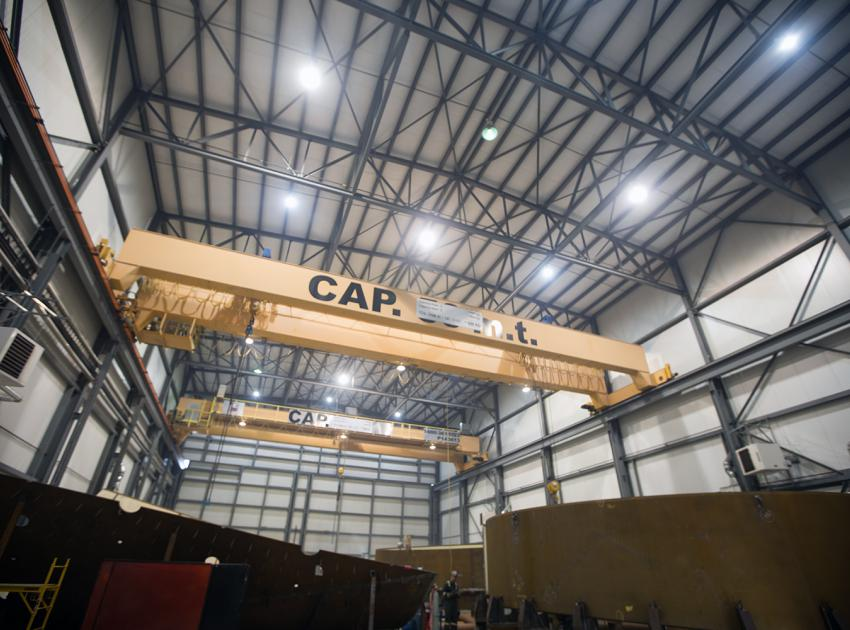Overhead cranes in the workshop in Fort St. John where our penstock parts are assembled. Penstocks are 10-metre-wide pipes that move water from the reservoir intakes to the turbines. (January 2019)