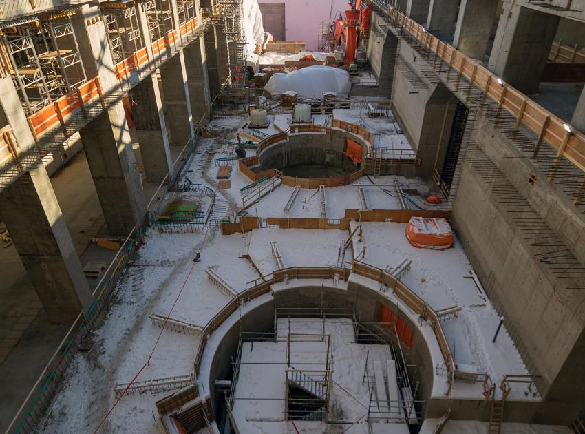Looking down the length of powerhouse at Units 1, 2, 3 & 4 from the Main Service Bay. (February 2020)