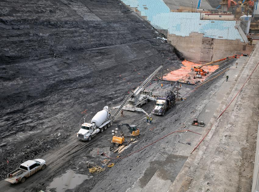 Roller-compacted concrete is being used to build the spillway buttress.  On top of this foundation, the spillways will be built to allow the passage of large volumes of water from the reservoir into the river channel downstream. (Spring 2019)