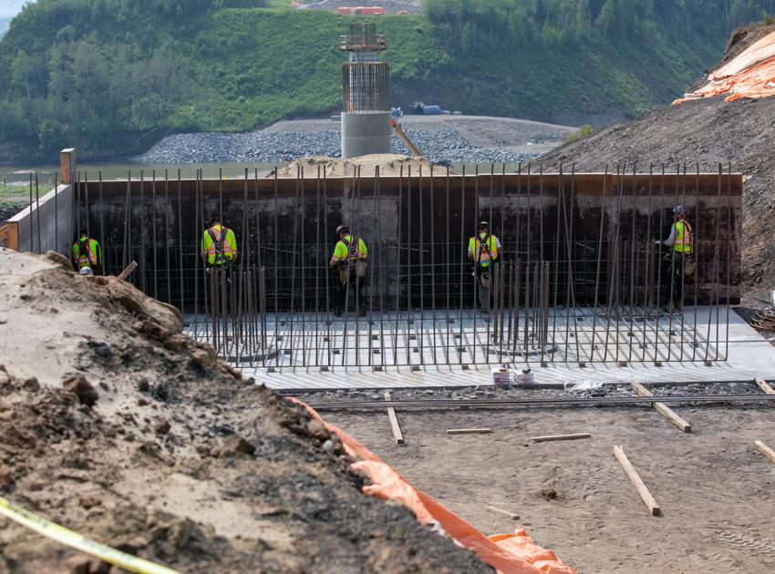 Workers install rebar for the east abutment of the Farrell Creek bridge on Highway 29. (July 2021)