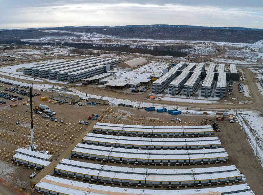 An expansion of the Site C worker accommodation lodge is underway. These wooden cribs are installed to prepare for the 450-bed camp expansion. The existing lodge is in the background. (March 2020)