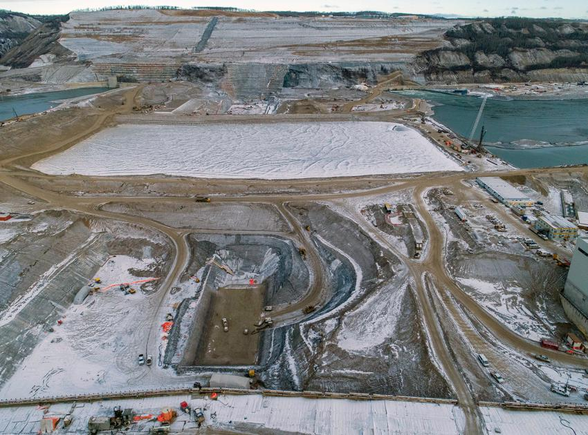 An aerial view of the south bank dam core trench looking north across the diverted Peace River. (December 2020)