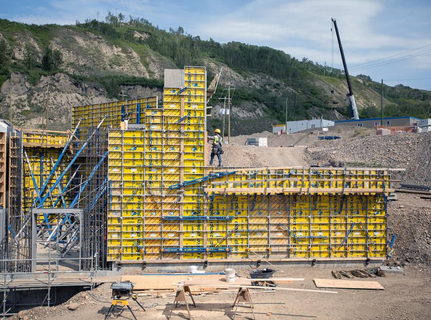 Construction of the temporary fish passage facility on the north bank, near the outlet portal of the diversion tunnels. (August 2019)