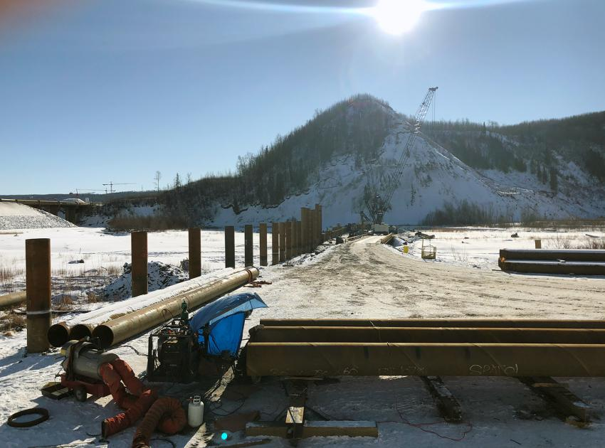 Piles are being installed across the Moberly River to catch floating debris during river diversion. Debris booms will also be installed across the Moberly River, as well as the Peace River. (February 2020)