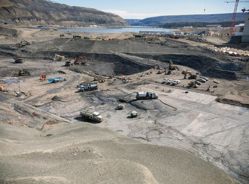 Crews clean the bedrock and excavate the dam core area where the earthfill dam will be constructed. (April 2021)