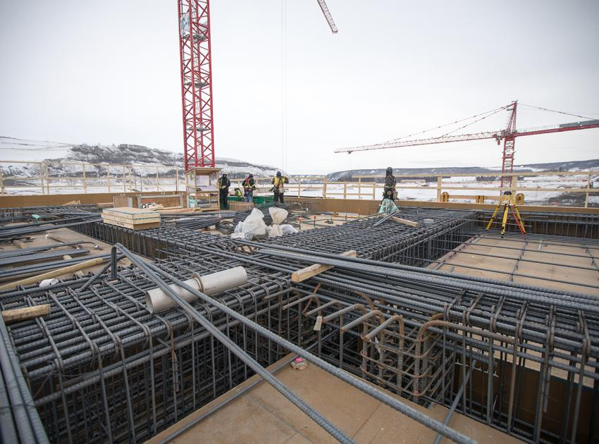 Rebar (short for reinforcing bar) is used to strengthen concrete structures. Here, rebar is installed in the main service bay before concrete is poured into the framework. (February 2019)