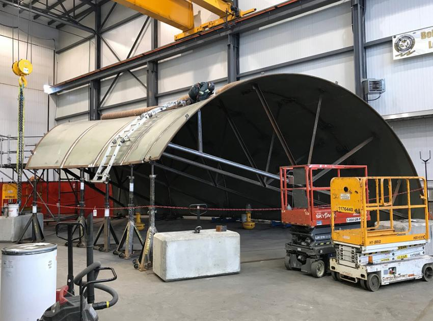 Once operational, water enters turbines through large spiral-shaped pipes known as spiral cases that are made of formed and welded steel plates. The bottom section of a spiral case is welded by a robot at the on-site manufacturing shop. (February 2019)
