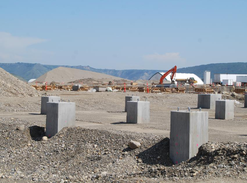 Concrete pedestals and concrete being poured in forms for the substation (August 2018)
