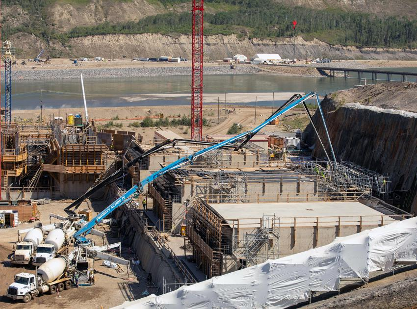 Concrete placement at the auxiliary spillway overflow channel. (July 2021)