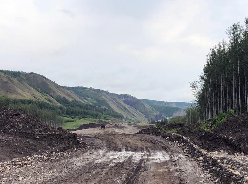 Grading is underway in the middle of the Lynx Creek Highway 29 road alignment. Material is removed to be replaced with fill sourced from Gates Island. (July 2021)