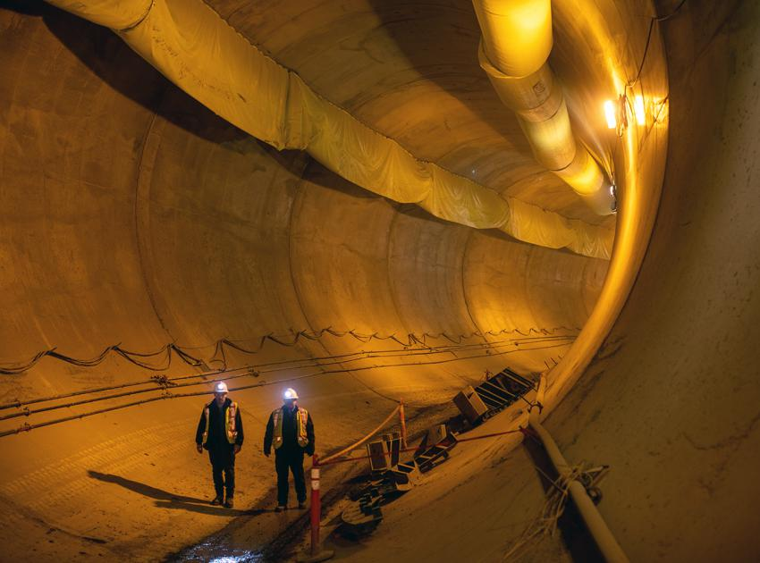 Workers walk through a segment of one of the diversion tunnels, recently lined with concrete. (November 2019)
