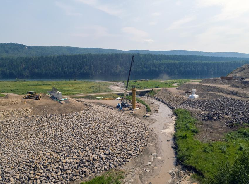 The Lynx Creek bridge alignment on Highway 29 showing the east abutment, bridge pier 2 formwork, pier 1 wrapped in plastic for concrete curing, and the west abutment under construction. (July 2021)