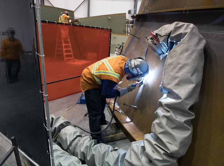 Turbines and generators contractor assembling equipment at their work area (November 2017)