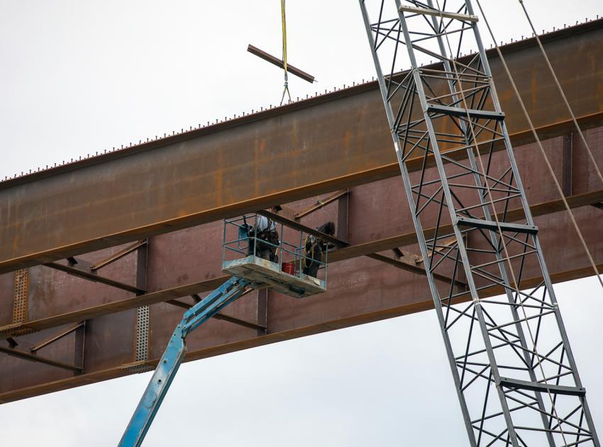 Steel cross-bracing is installed between the Dry Creek bridge girders. (August 2021)