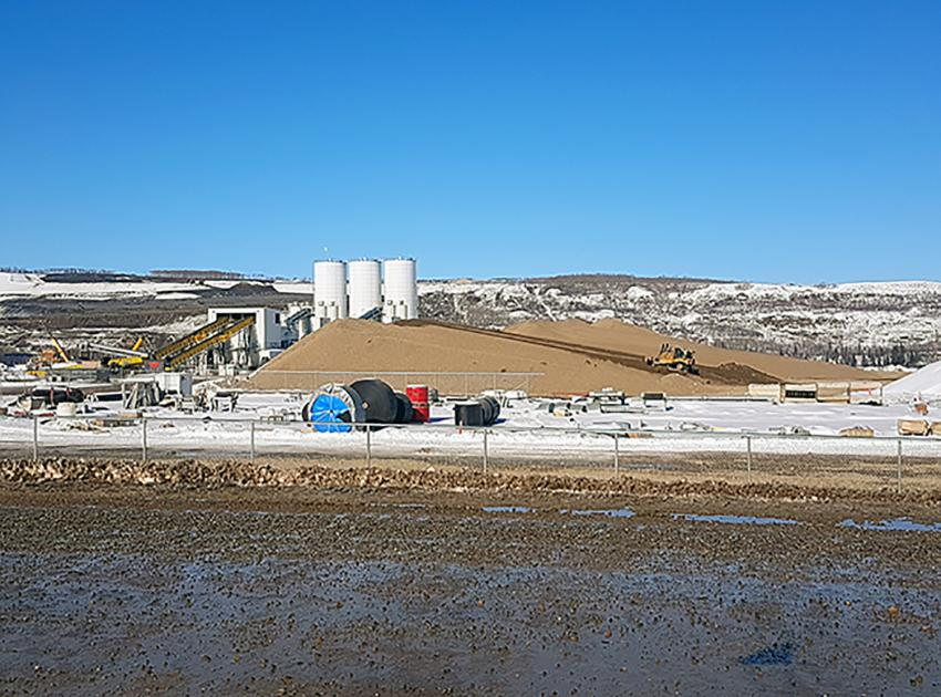 Concrete batch plants and aggregate stockpile on the south bank (April 2018)
