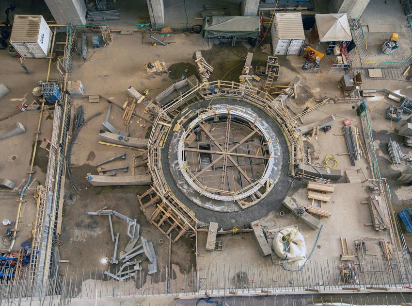 Second stage concrete curing is underway around the unit 4 draft tube cone. (July 2021)
