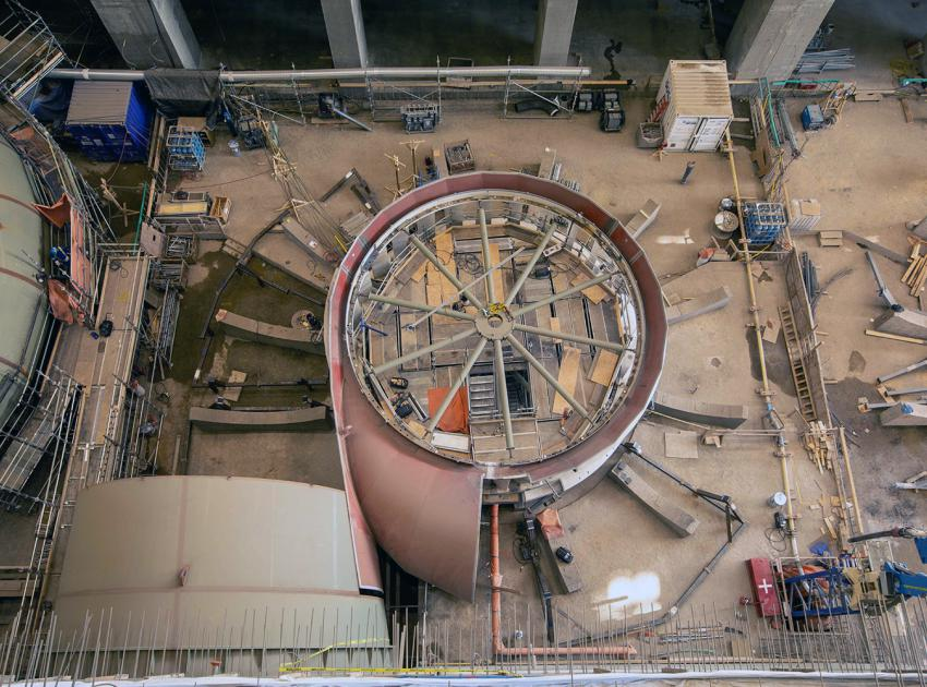 The unit 3 thrust ring and stay ring have been installed. Crews are building the temporary supports for the spiral case installation. (July 2021)