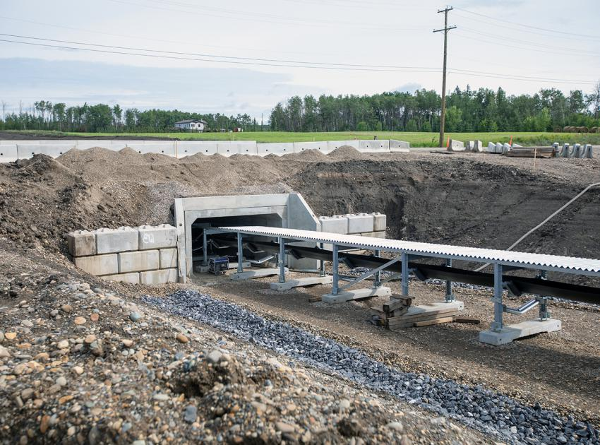 Using a box culvert design, the 5-km till conveyor system crosses under two roadways in Fort St. John, one at 240 Rd. and the other at Old Fort Rd. (July 2019)