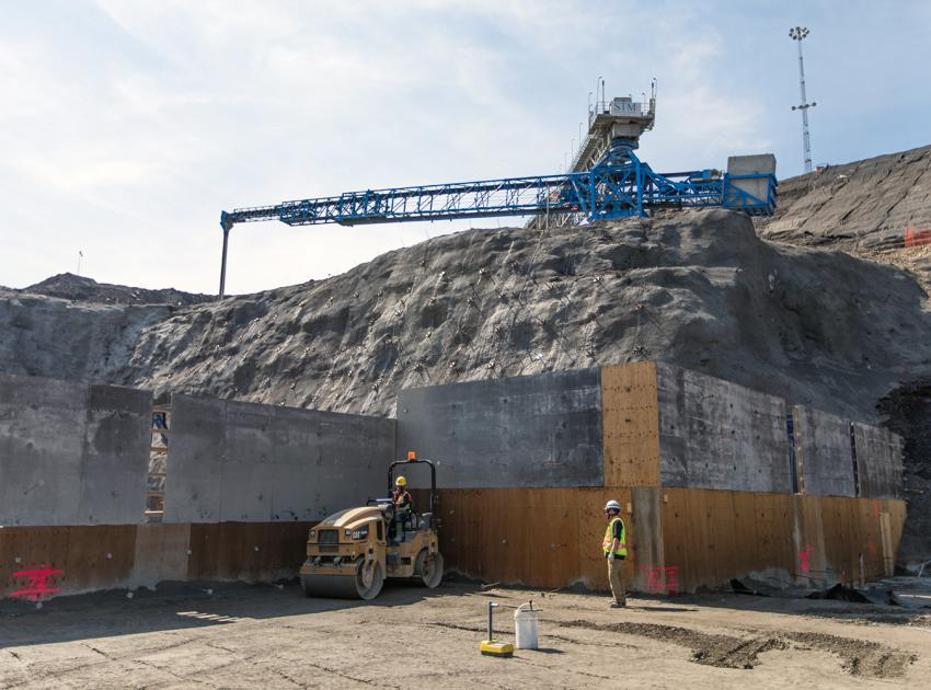 RCC placement and shotcrete application for the spillway buttress on the south bank (June 2018)